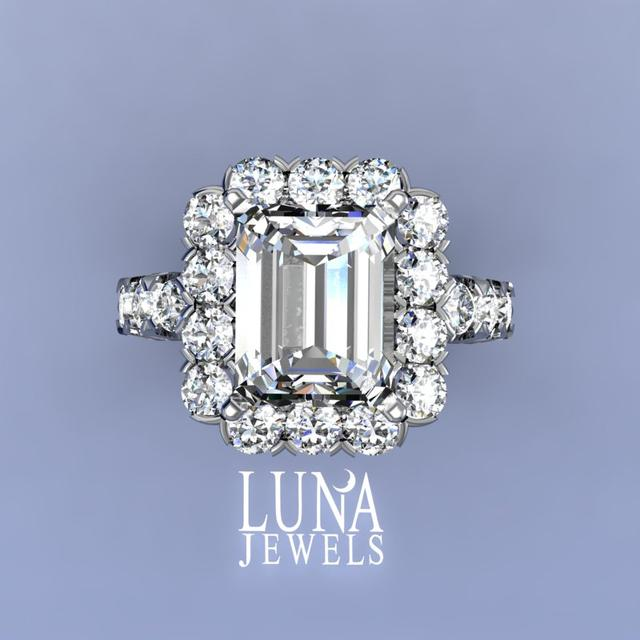 Diamond frame ring with Emerald cut diamond